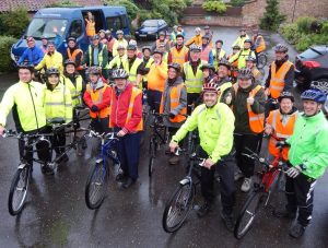 A large group of tandem cyclists in high-viz