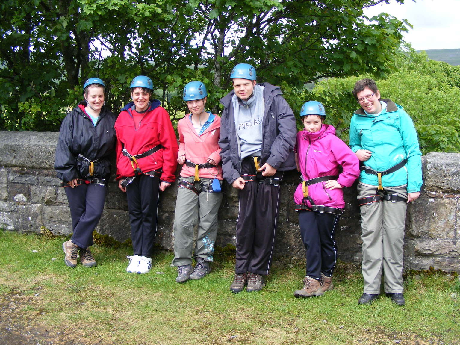 People wearing helmets and harnesses, all set to abseil off the viaduct.