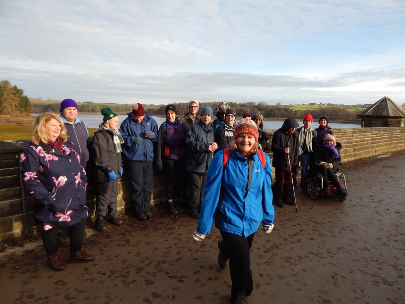One of the Open Country Walking groups enjoying a walk by a reservoir.