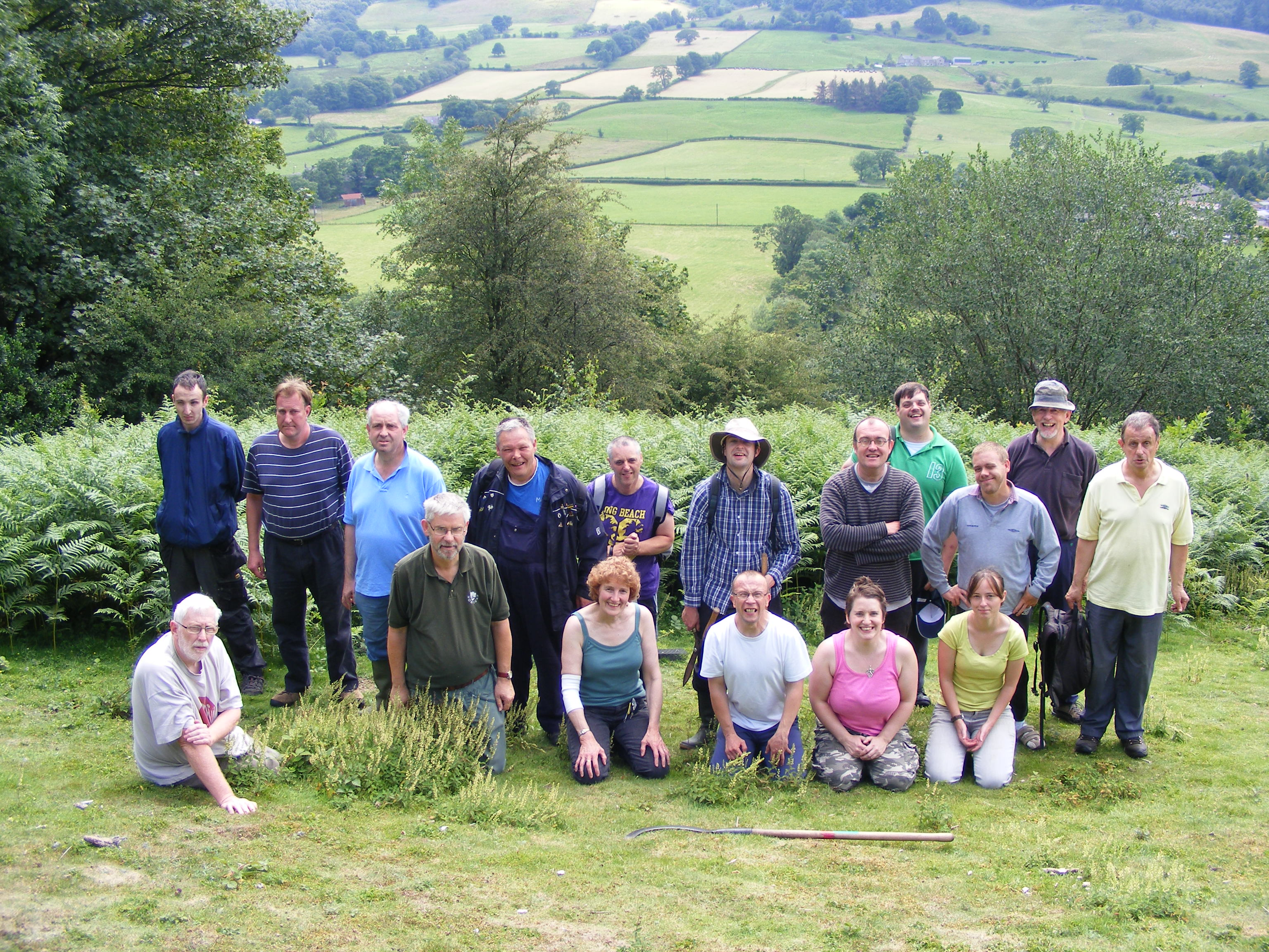 The conservation group on a summer's day with hills and trees in the background.