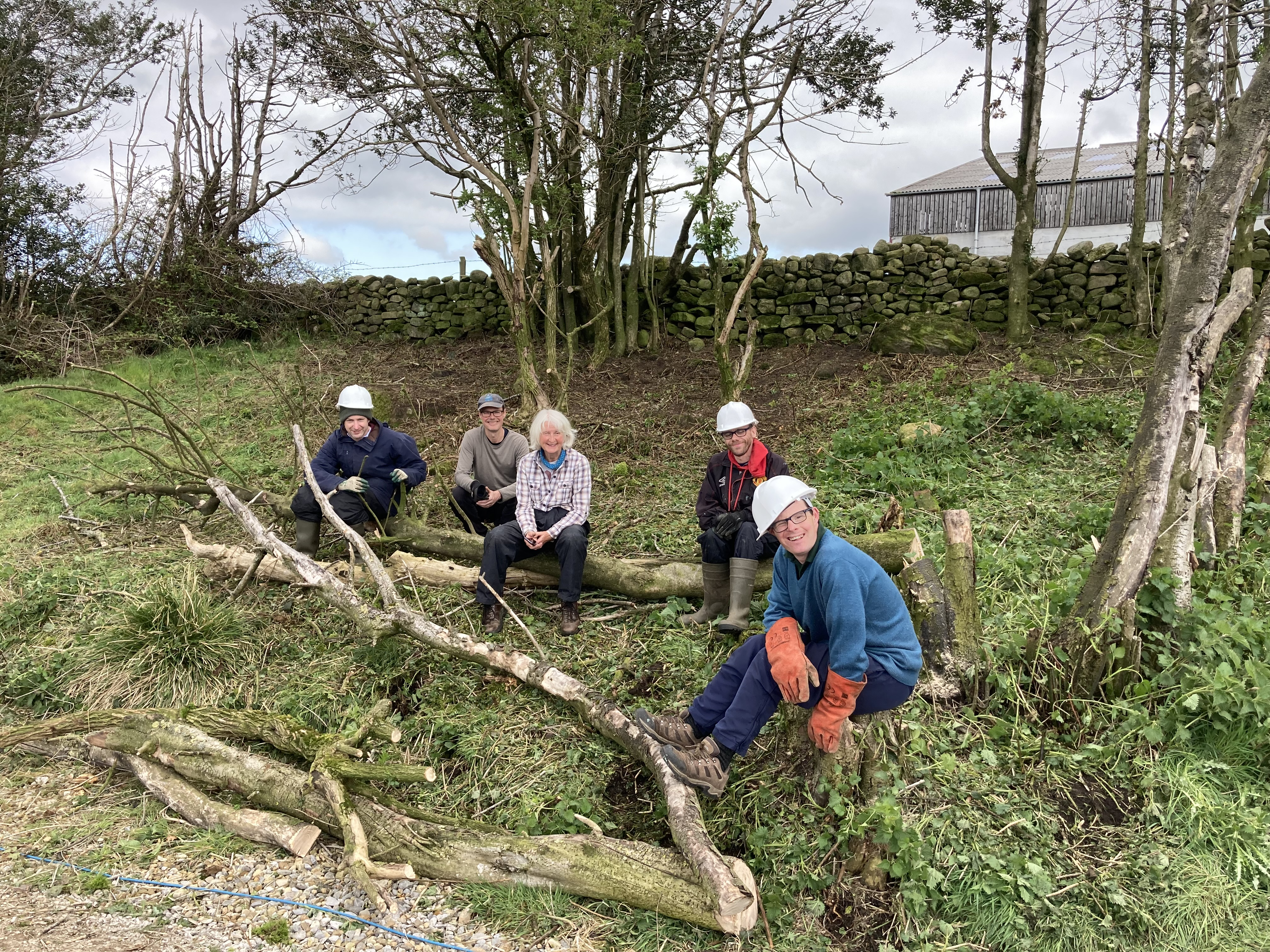 The conservation group having a rest after felling some trees.