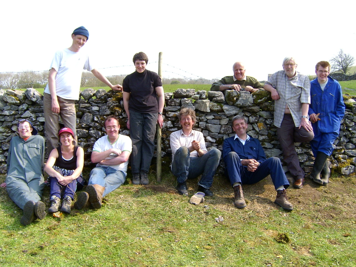 The conservation group having a rest after working on a dry stone wall.