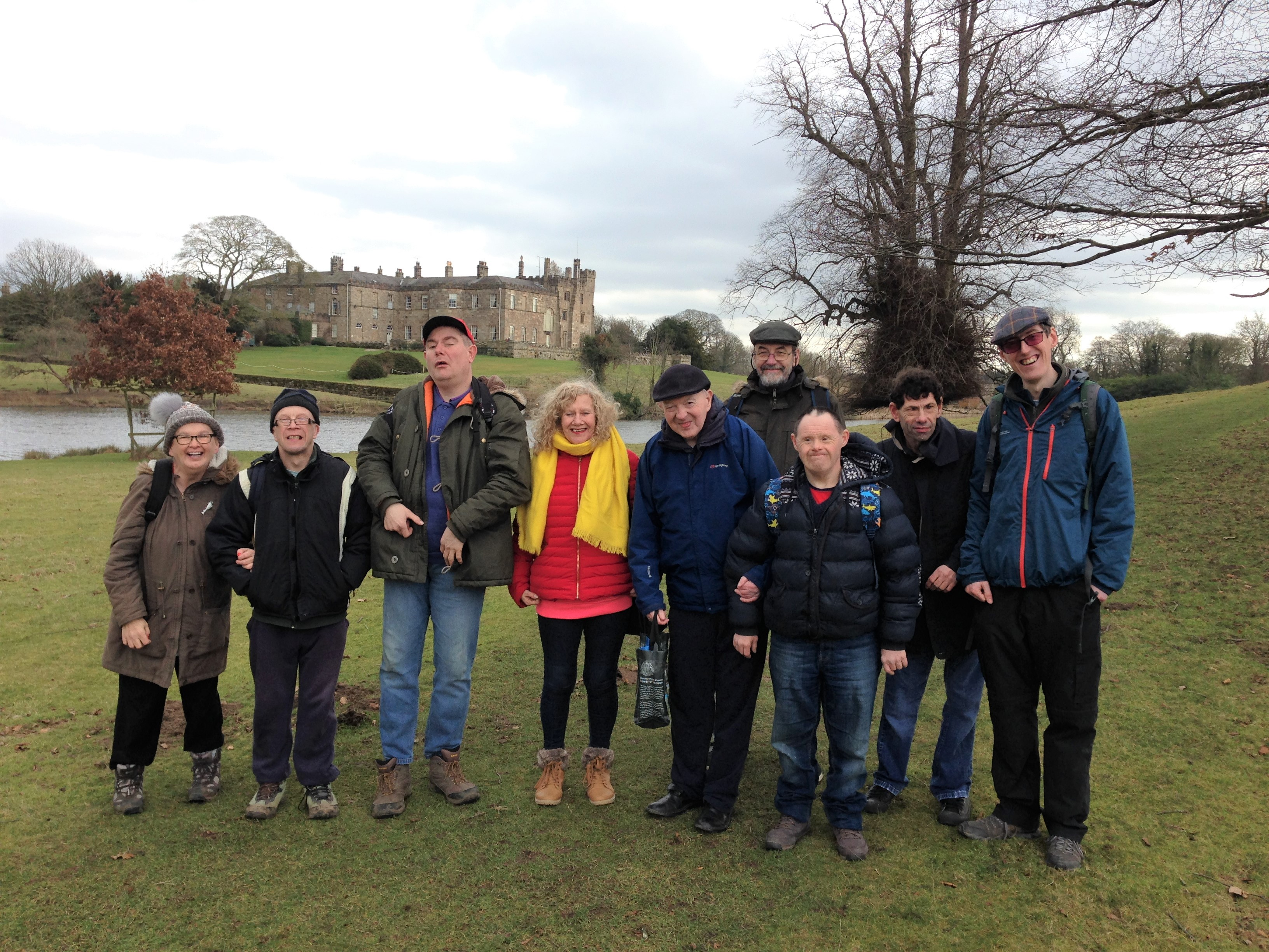 The Wild About Wetherby group sitting on a bench with heathland and trees in the background.